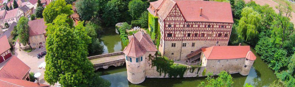 Panorama Wasserschloss Unsleben Ferienwohnungen